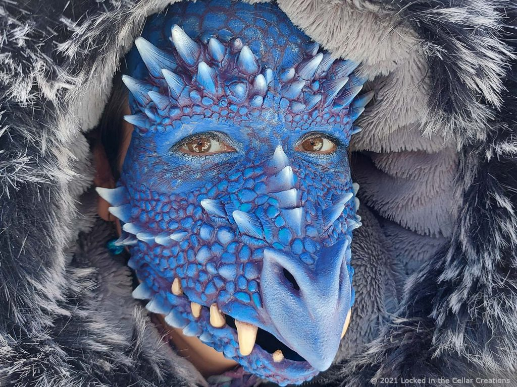 Add blue and purple face paint to your dragon face mask & forehead horns prosthetics and make your larp/cosplay look complete.