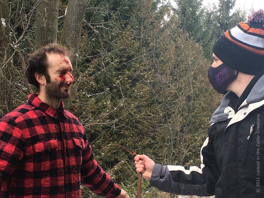 Brian sprays fake blood on actor Michael Masurkevitch